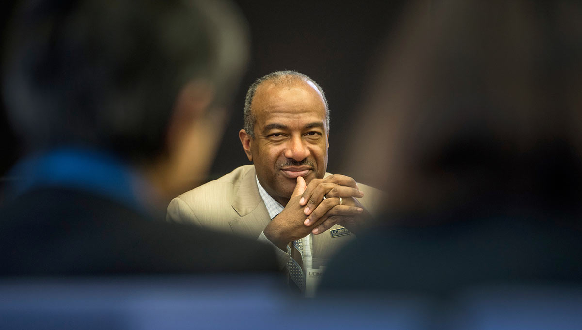 UC Davis Chancellor Gary May smiles at a meeting