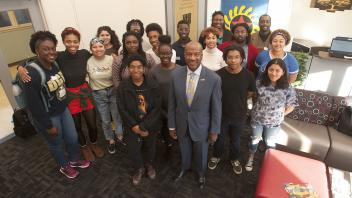 UC Davis Chancellor Gary May stand with students at the Center of African Diaspora Student Success on December 1, 2017.