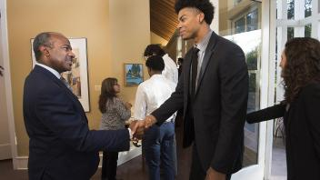 UC Davis Chancellor Designate Gary May greets student athlete Garrison Goode... Dinner at the Chancellor's Residence