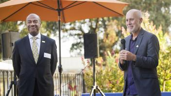 UC Davis Chancellor Gary May is introduced by Rob Davis, the mayor of the City of Davis during the Chamber Mixer held at the El Macero Country Club in Davis on August 16, 2017.