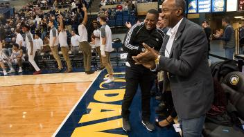 Chancellor May cheers courtside at the last home basketball game of the season.