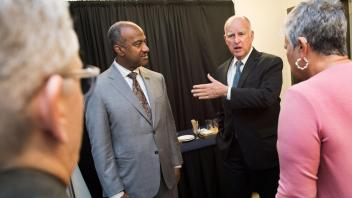UC Davis Chancellor Gary May and Governor Jerry Brown chat before joining the symposium honoring the California Air Resources Board 50th Anniversary Symposium at the UC Davis Conference Center on Friday, January 19, 2017.