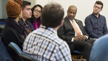 Chancellor Gary May listens to a group of students at the Transformative Justice Center
