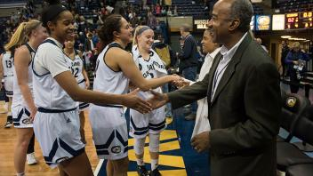 Chancellor Gary May and his wife LeShelle May congratulate the UC Davis Women's Basketball team on their last home game of the season.