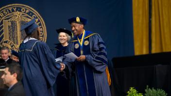 Chancellor May congratulates a graduating UC Davis student at commencement.
