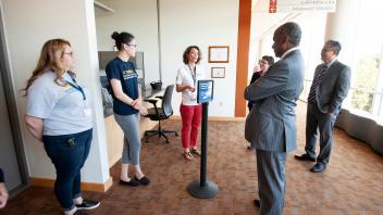 Chancellor May visits with staff at the Student Health and Wellness Center.