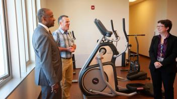 Chancellor May tours the physical therapy center at the Student Health and Wellness Center.