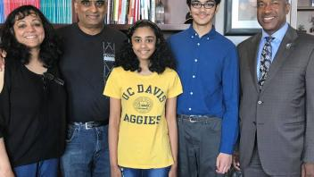 Chancellor May invited Tanishq Abraham, a 14-year-old UC Davis biomedical engineering graduate, and his family to his office.