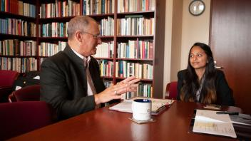 Provost Ralph Hexter talks with student shadow Namrata Kumar and the Dean of the School of Law Kevin Johnson about the level of Law School admissions with listening. Namrata, who is part of the Leadership Shadowing Program, is interested in applying to law school.