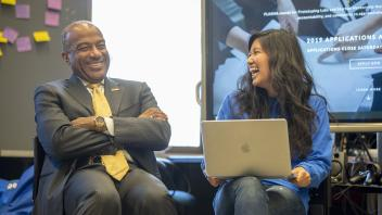 Chancellor May shares a laugh with Computer Science student, Michaela Poblete during his visit to the UC Davis Student Start-up Center in Bainer Hall on October 16, 2018.