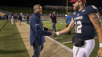Chancellor May congratulates Quarterback Brock Johnson after the UC Davis Aggies beat Northern Iowa State 23-16 on Saturday, December 2018 at Aggie Stadium during the round two Division playoff game.