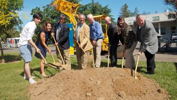 UC Davis Provost Ralph J. Hexter breaks ground with shovel and people