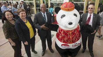 UC Davis Provost Ralph J. Hexter celebrates international cuisine with an Asian Panda mascot
