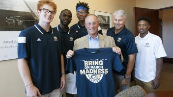 UC Davis Provost Ralph J. Hexter with basketball team