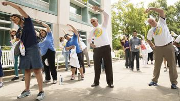 UC Davis Provost Ralph J. Hexter exercises outdoors with the UC Davis community