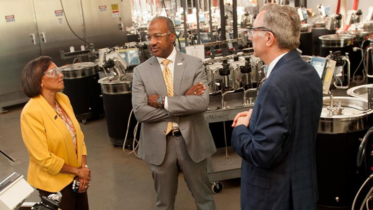 Chancellor Gary May and Dean Helene Dillard are led on the tour of the Robert Mondavi Institute of Food and Wine by Professor David Block on September 18, 2017, and view the high-tech wine barrels.