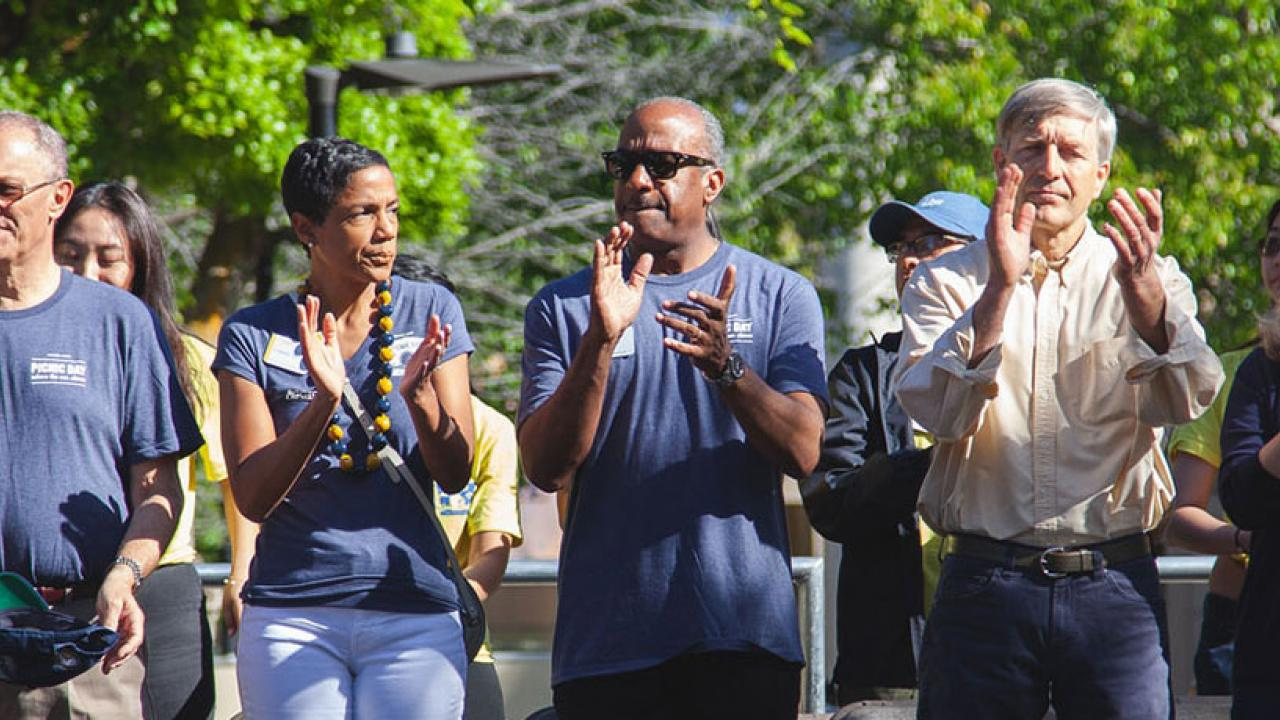 Provost Ralph Hexter, LeShelle May and Chancellor May applaud the Cal Aggie Band-uh from the Grand Stand at Picnic Day.