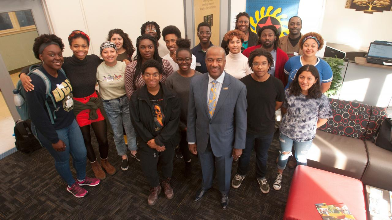 Chancellor Gary May stands with students at the Center of African Diaspora Student Success