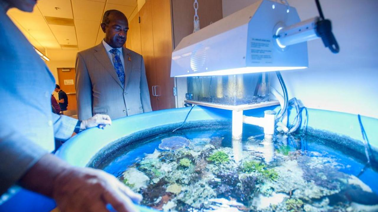 Chancellor Gary S. May visits the College of Biological Sciences.