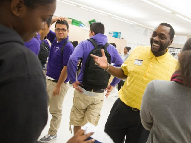 A member of the UC Davis staff visits Sacramento High School