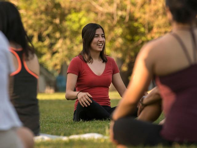 UC Davis students practice meditation on the quad