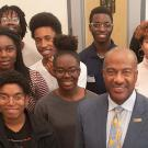 UC Davis Chancellor Gary May stand with students at the Center of African Diaspora Student Success on December 1, 2017