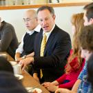 Provost Ralph J. Hexter speaks at a conference table at UC Davis