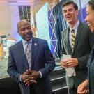 Chancellor Gary S. May standing next to journalist Dan Brown '92 and San Francisco Mayor London Breed '97 in August.