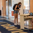 Students entering Shields Library on the first day of instruction must show their daily symptom surveys and scan their ID cards.