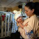 Liliya Bachinskiy holds baby Micaela, three days after the 9-month-old was successfully separated from her conjoined twin, Abigail, at UC Davis Children's Hospital.